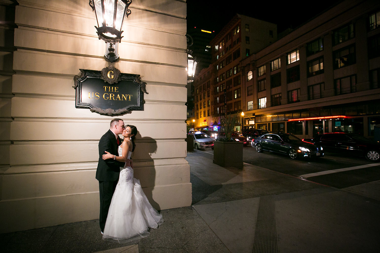night shot with bride and groom at us grant hotel