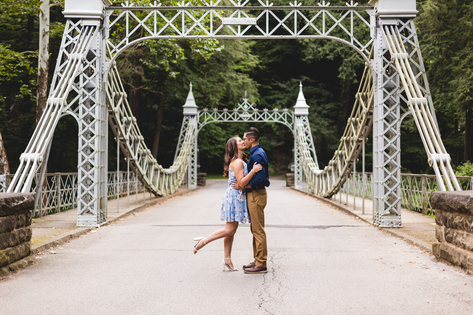 youngstown ohio engagement photography kissing on bridge