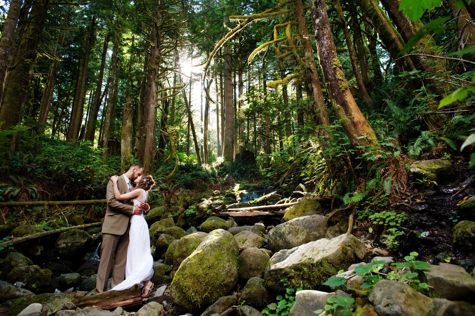 wedding couple kiss in woods