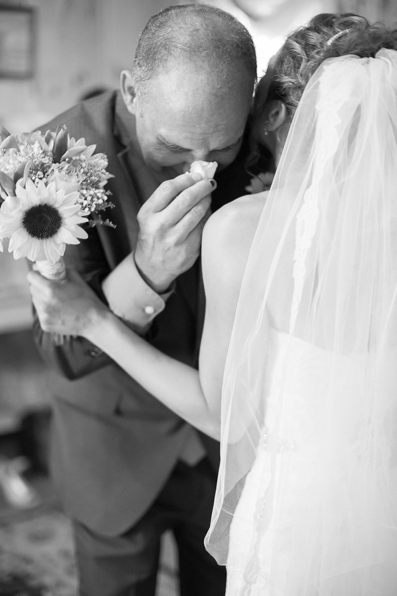 emotional image of a bride and her father in frederick md