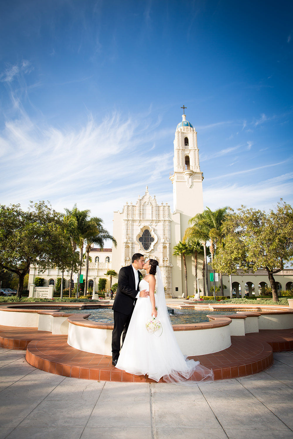 bride and groom in front of the immaculata