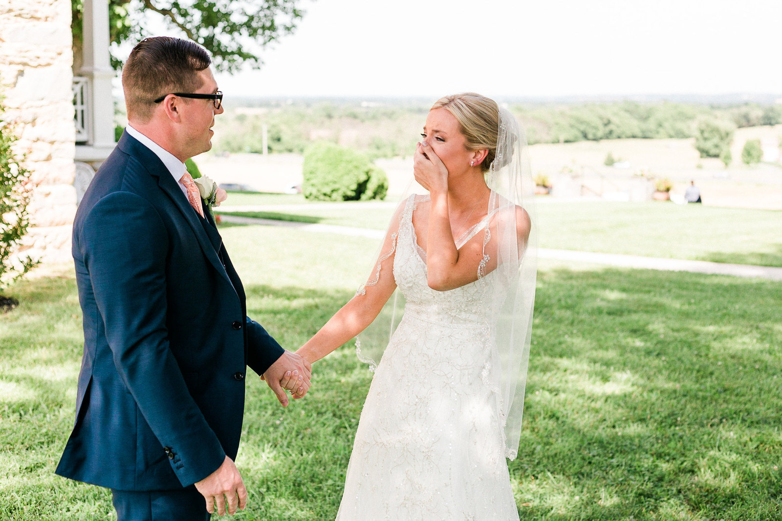 Bride cries as she sees her groom during the first look