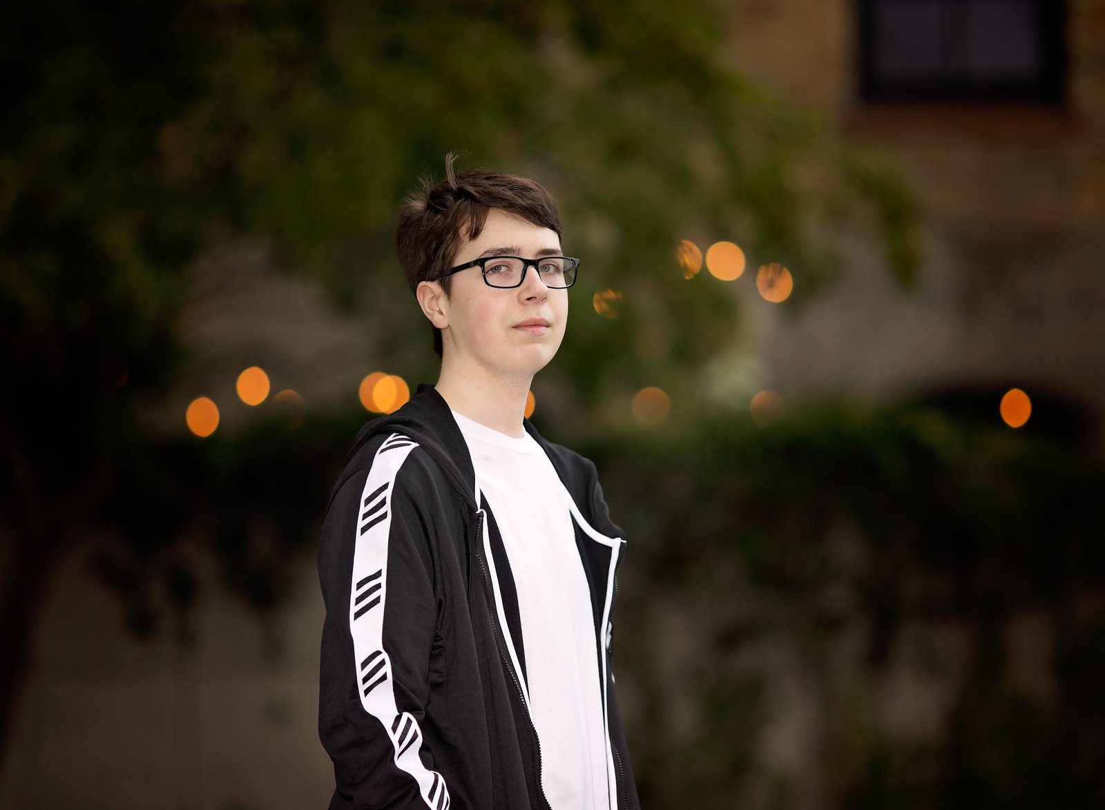 Senior portraits of boy with Bokeh in background