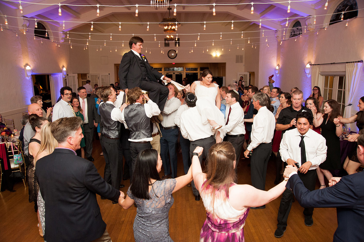 bride and groom on chairs dancing