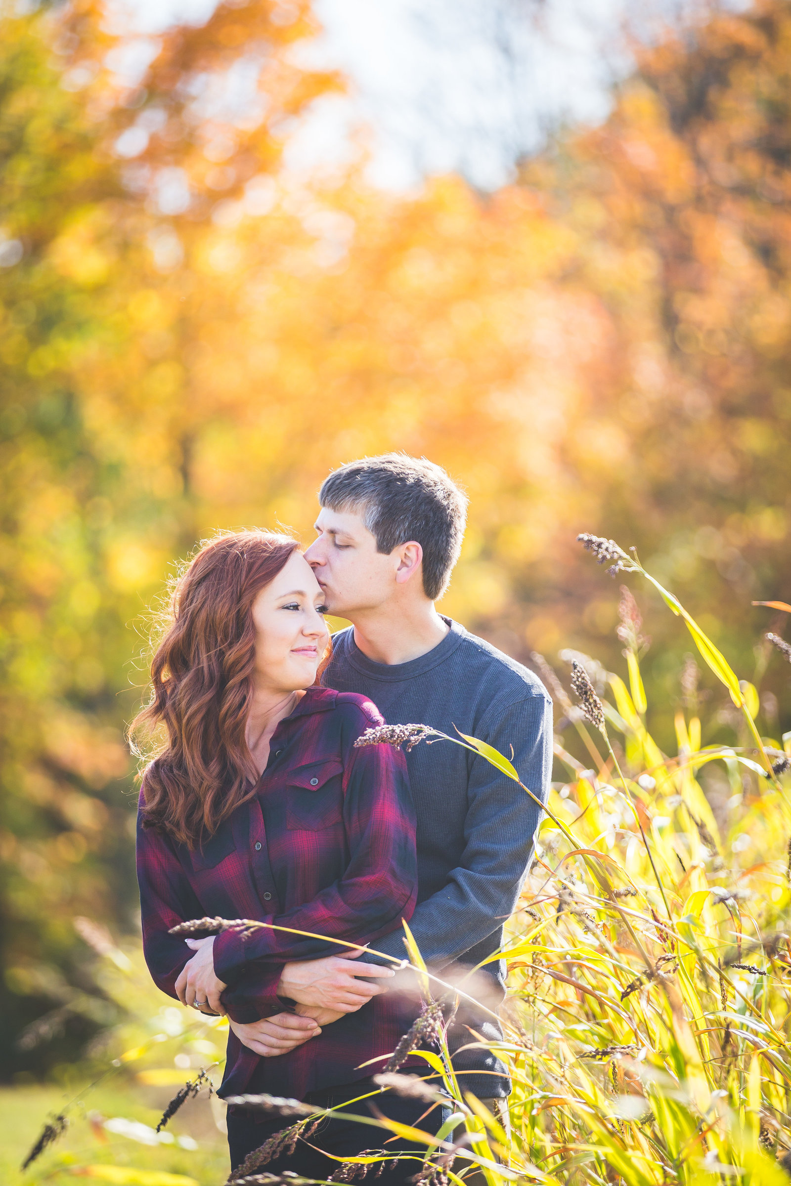 engagement session of Taylor and Kyle at Robbinettes Orchard in Grand Rapids MIchigan