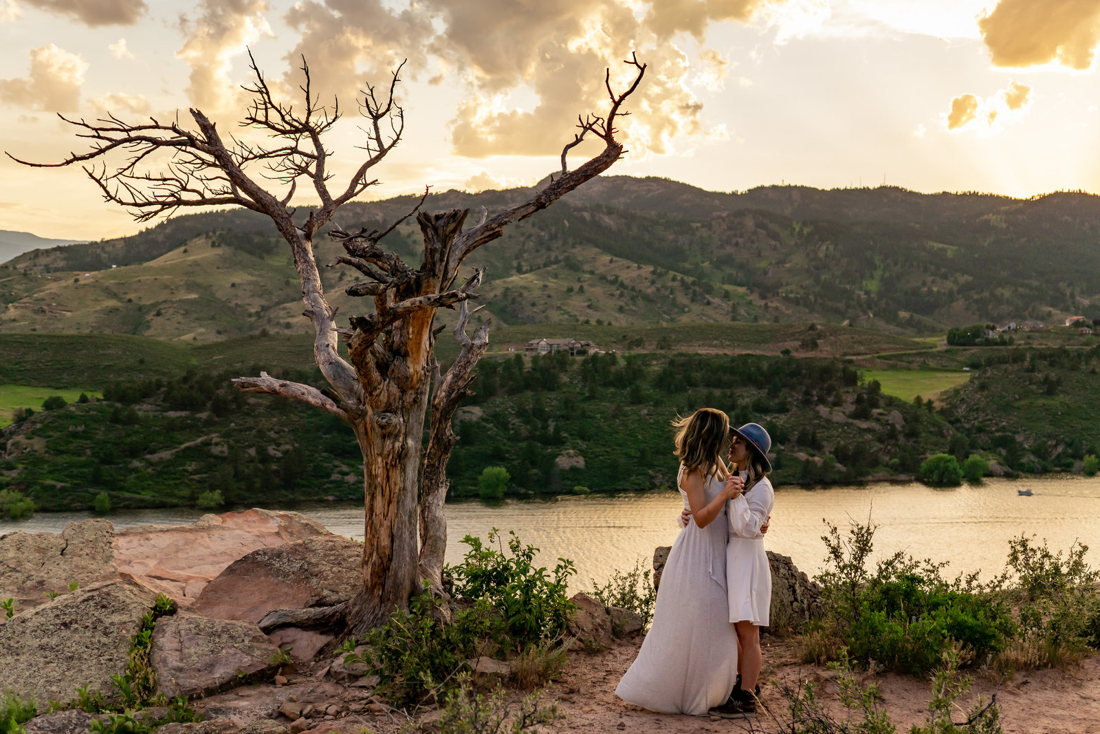 LGBT Couple Dancing in Front of a Colorado Sunset Elopement Inspiration by Gabby Jockers Photography