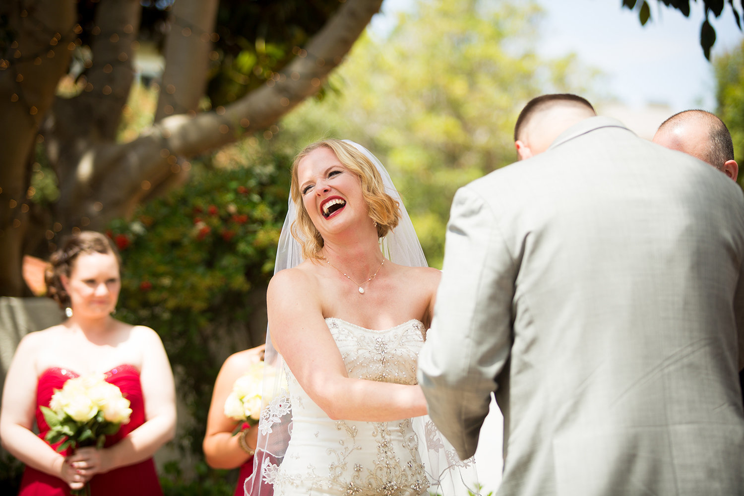 bride laughing at groom saying his vows at darlington house