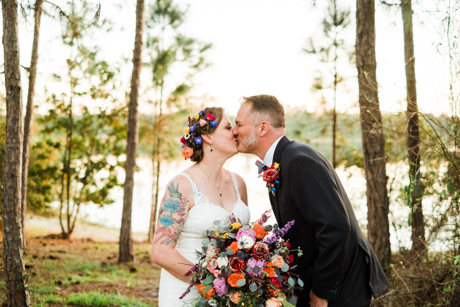 Bride and groom kiss on the lips at their wedding in Ocala National Forest