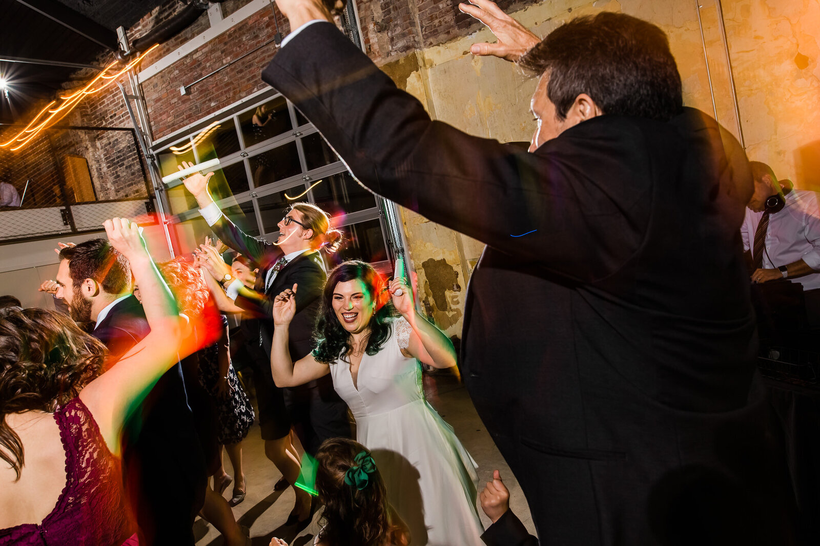 Guests dancing and having fun at a wedding reception at Wild Carrot in St. Louis