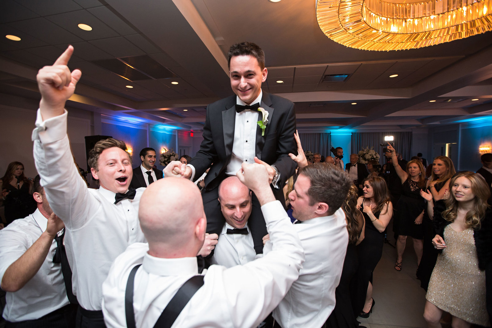 groom getting lifted by his groomsmen at Engineers Country Club