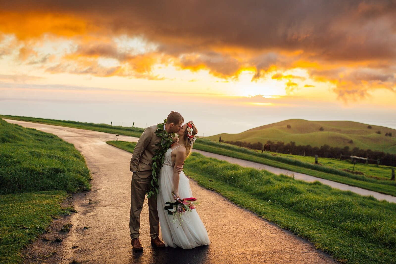 wedding couple kissing at sunset