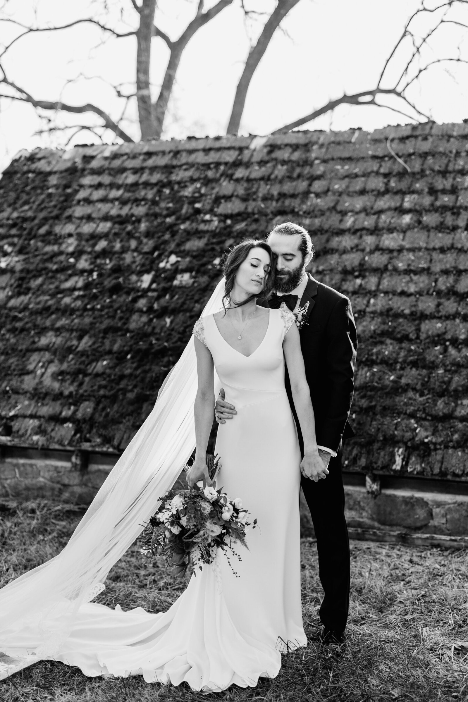 black and white bride and groom at old barn
