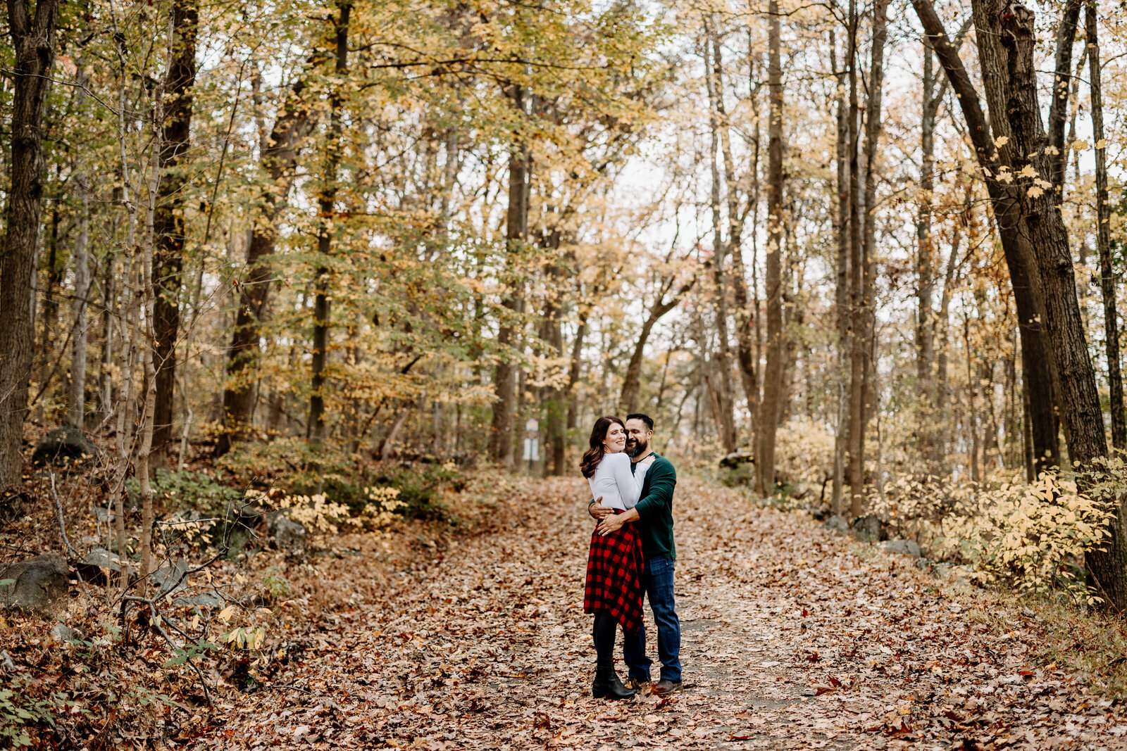 engaged couple fall woods