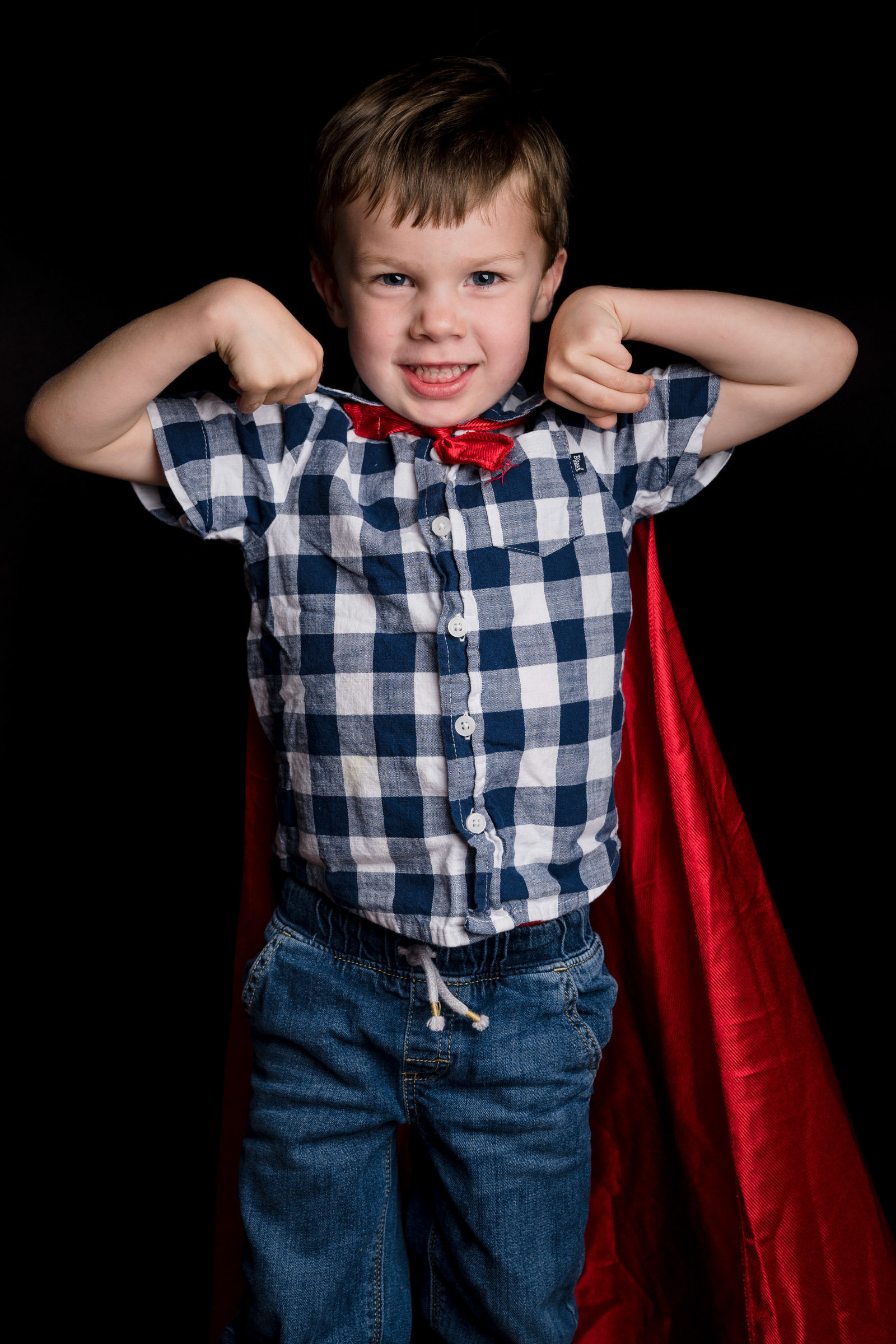 boy posing with cape