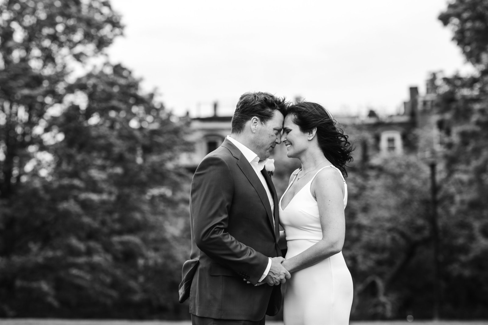 black and white image of bride and groom standing touching foreheads in massachusetts elopement