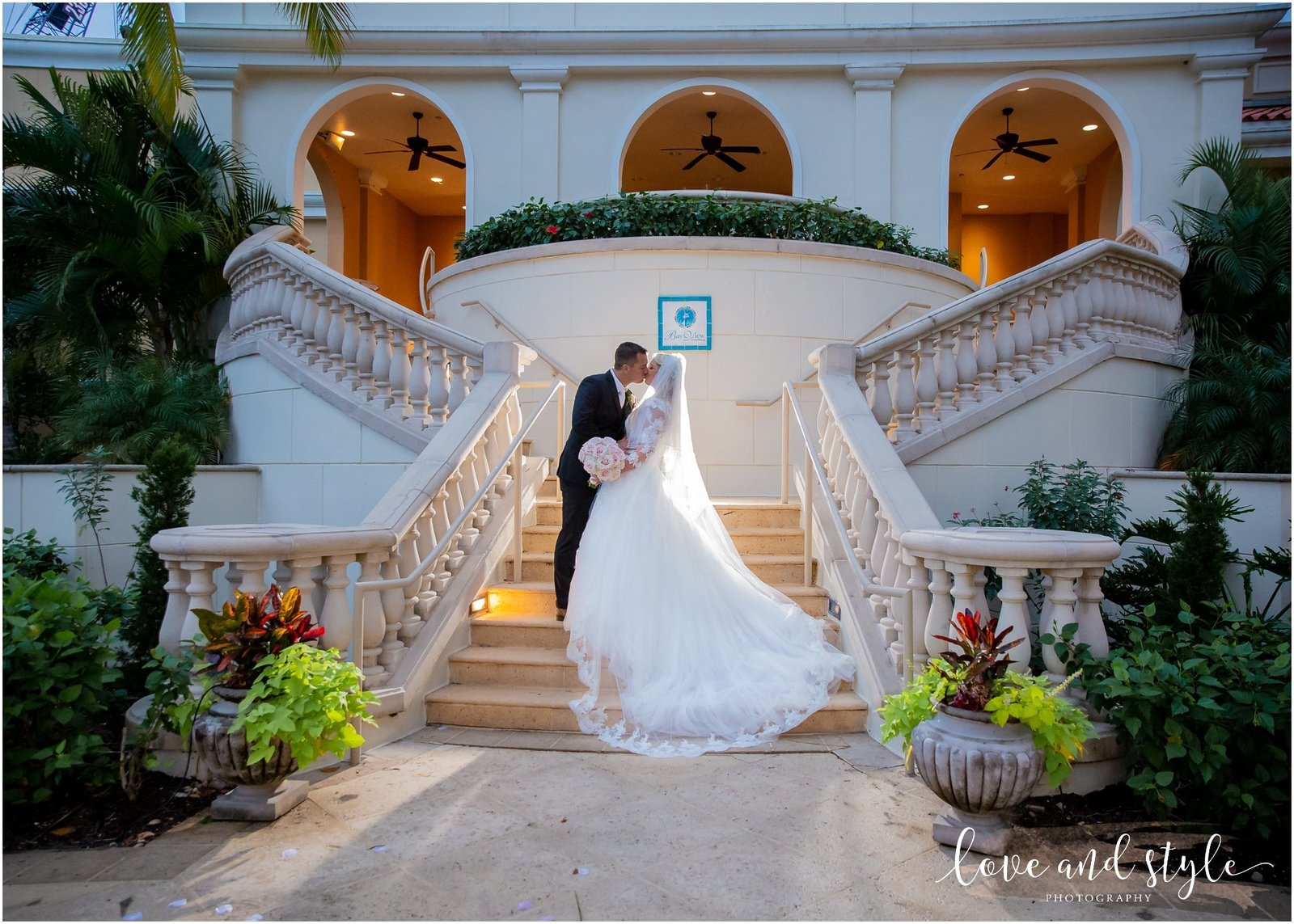 Bride and groom kissing backlit at The Ritz Carlton, Sarasota