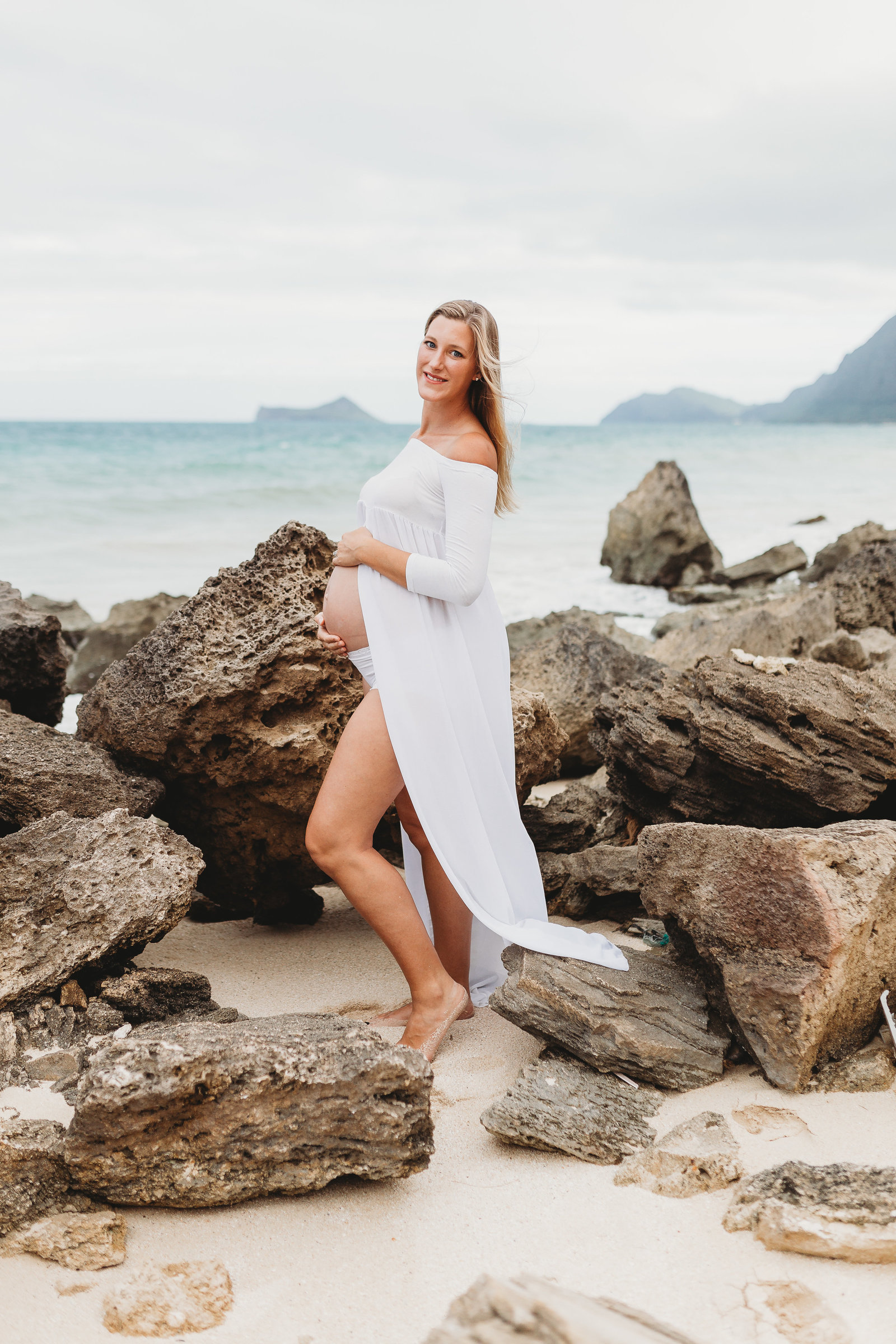 Maternity Photography Shoot - Pregnant Girl on Beach standing with Rocks - Honolulu, Oahu, Hawaii - Brooke Flanagan Maternity Photographer