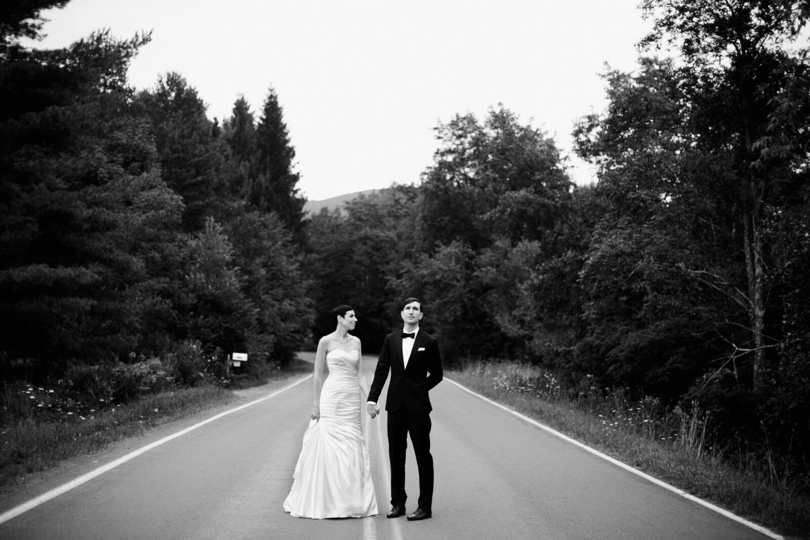 bride and groom on mountain road