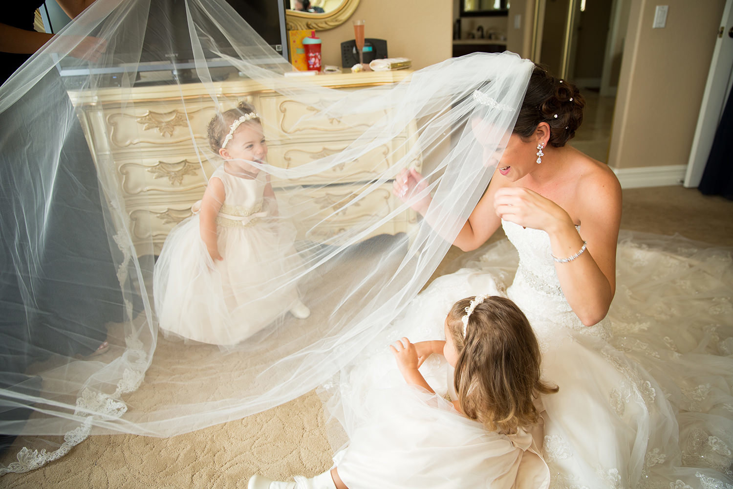 Wonderful moment between the bridesmaid and her flower-girls