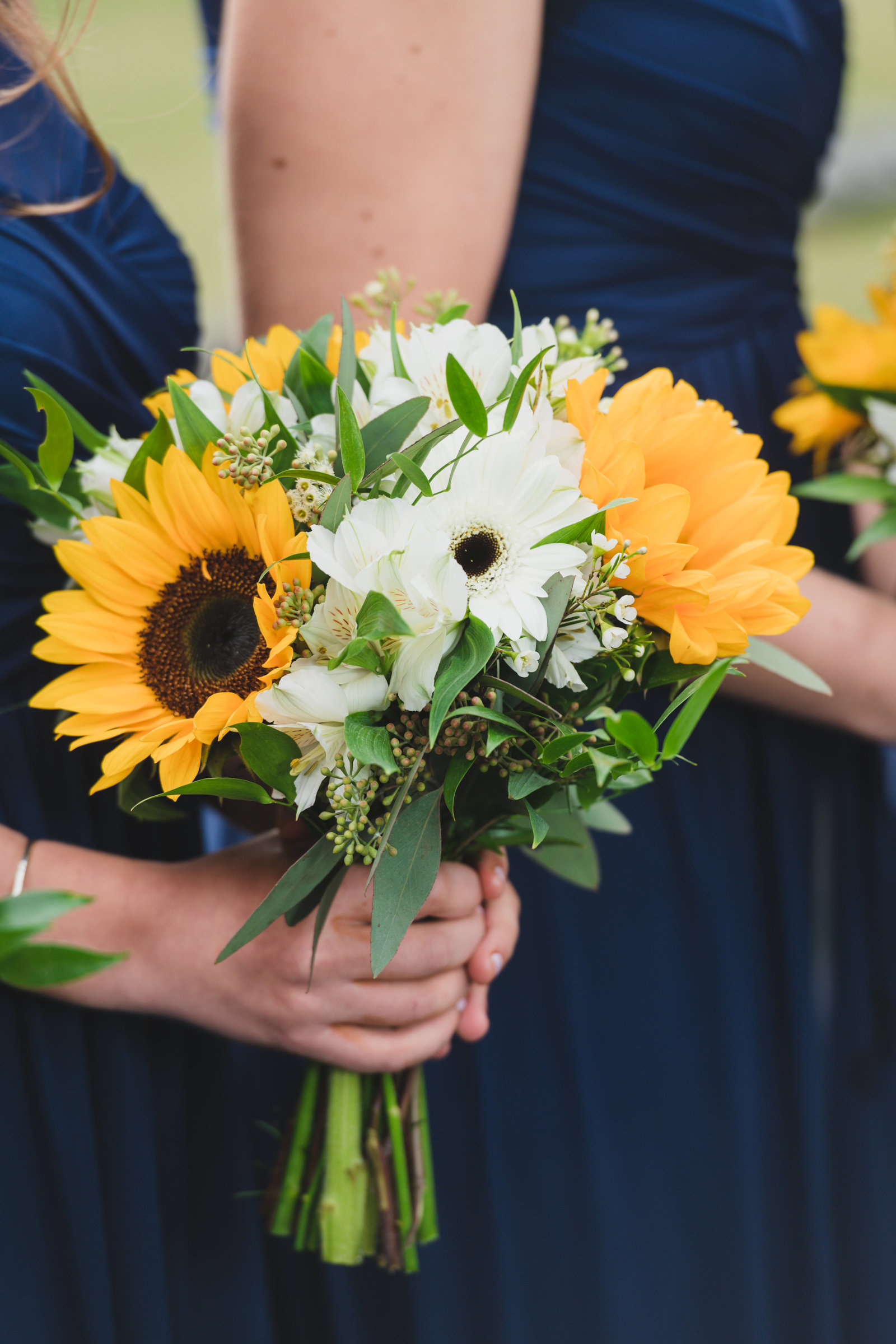 photo of bridesmaids bouquet in hands from wedding at Three Village Inn