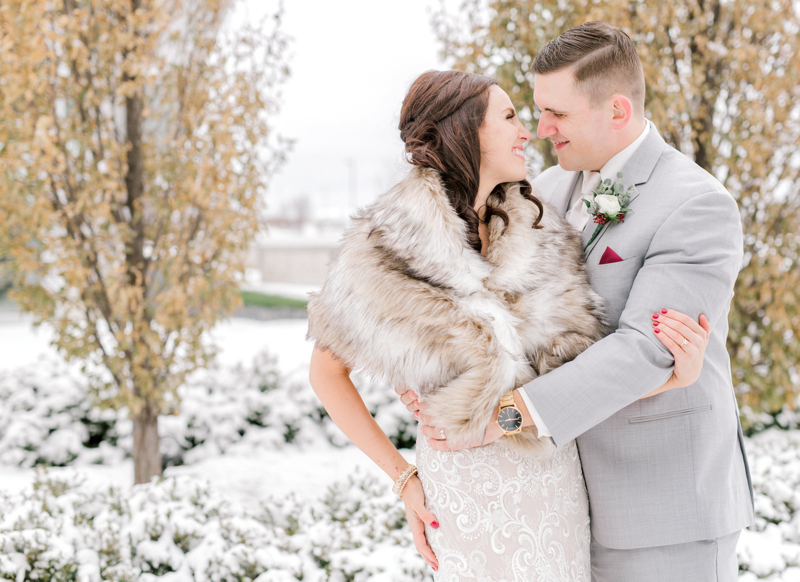 bride and groom embrace during winter wedding