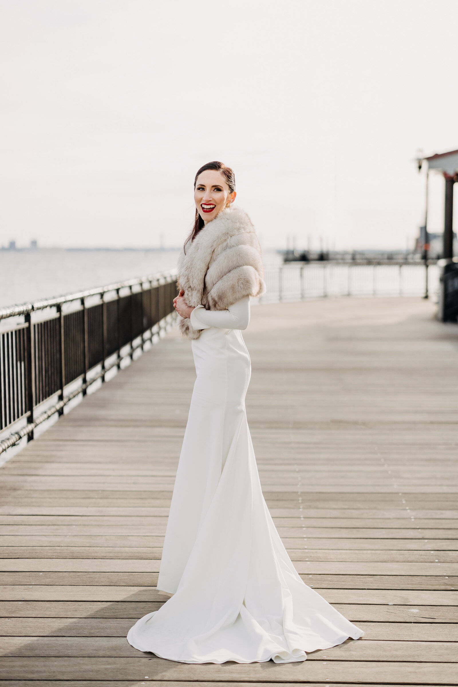bride on boardwalk jersey city with fur shaw