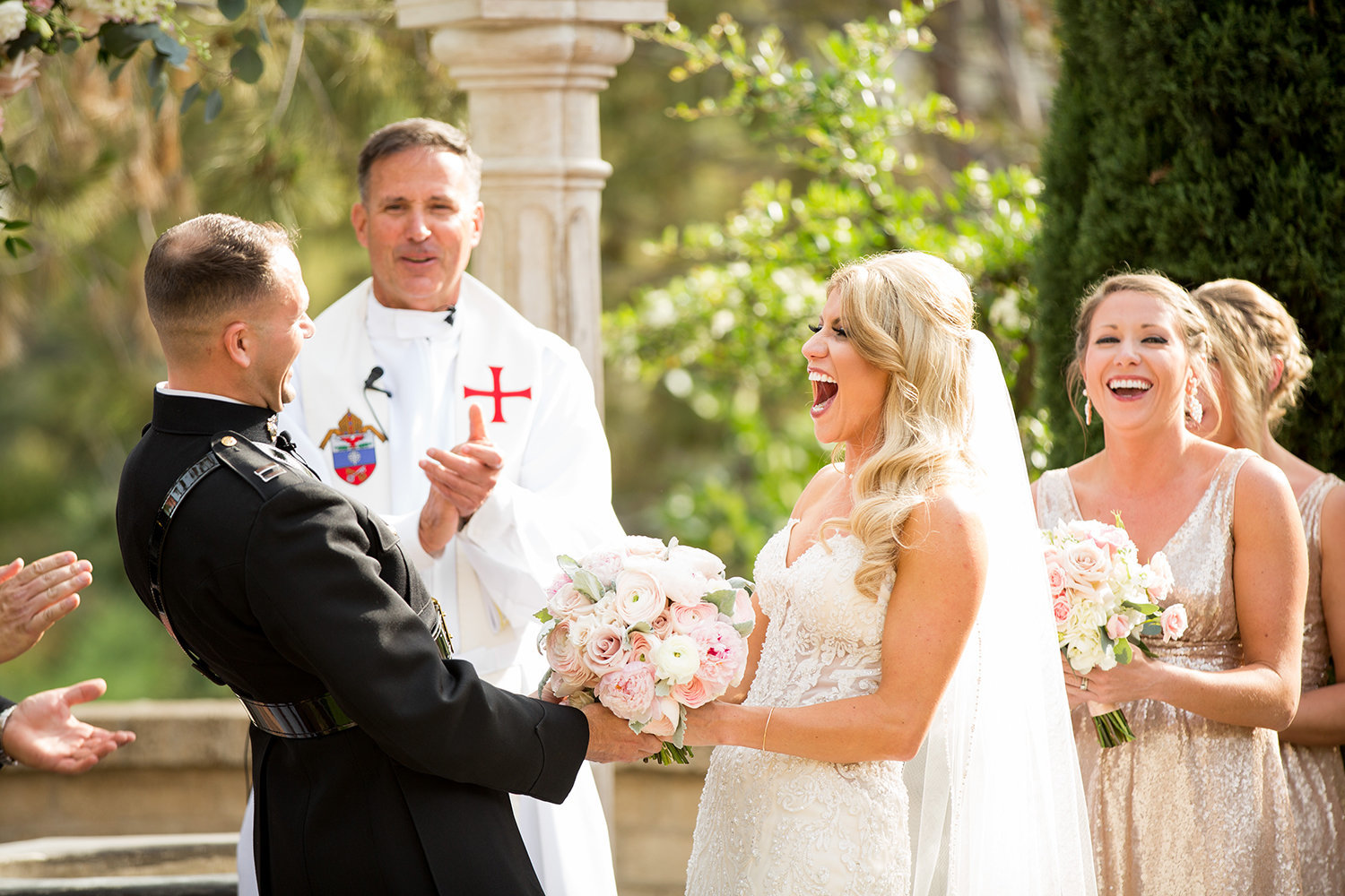bride and groom at ceremony wishing well the prado Laughing