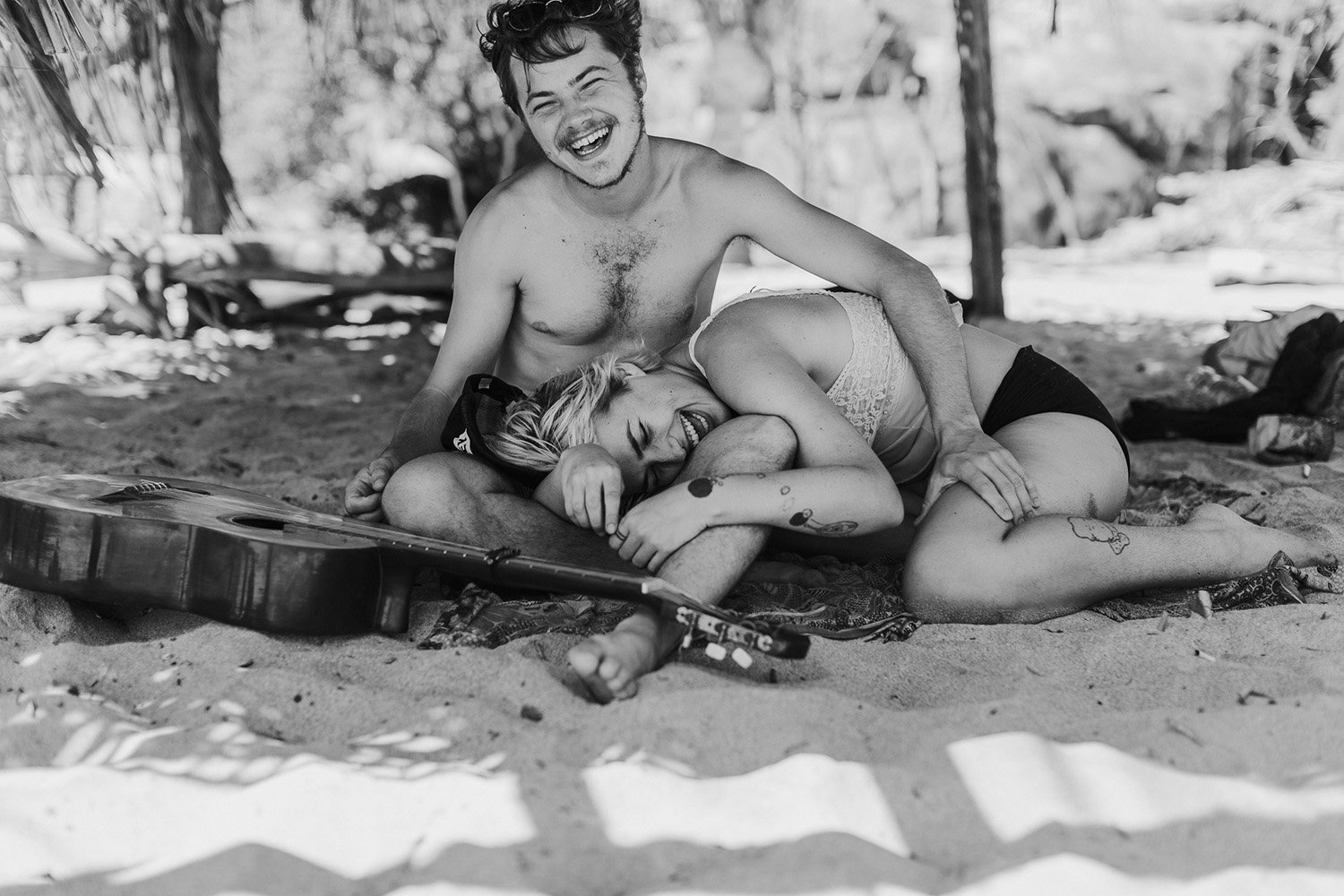 Couple laughing on the beach in Mexico