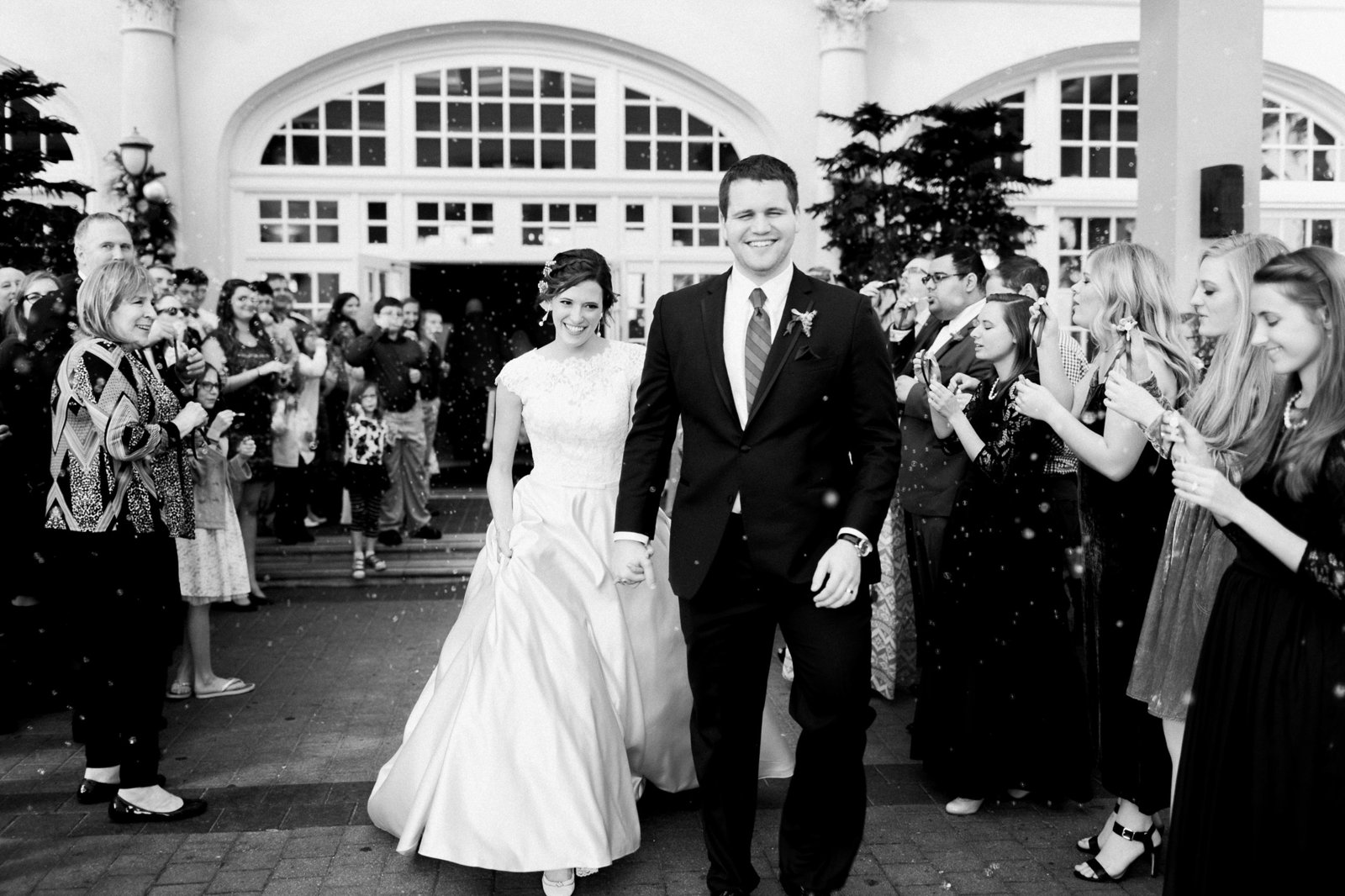 Black and white wedding photography of Bride and Groom exiting their classic wedding ceremony.