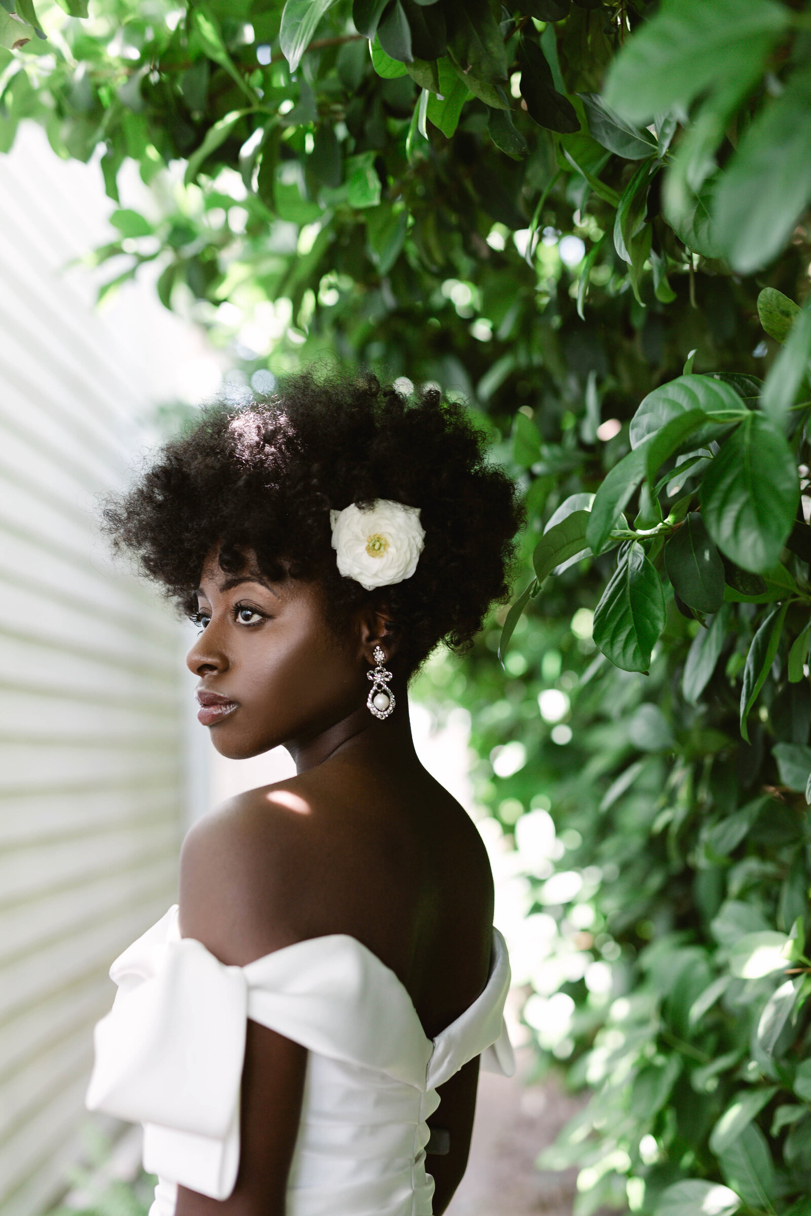 Bride with beautiful skin in New Orleans with  hair flower