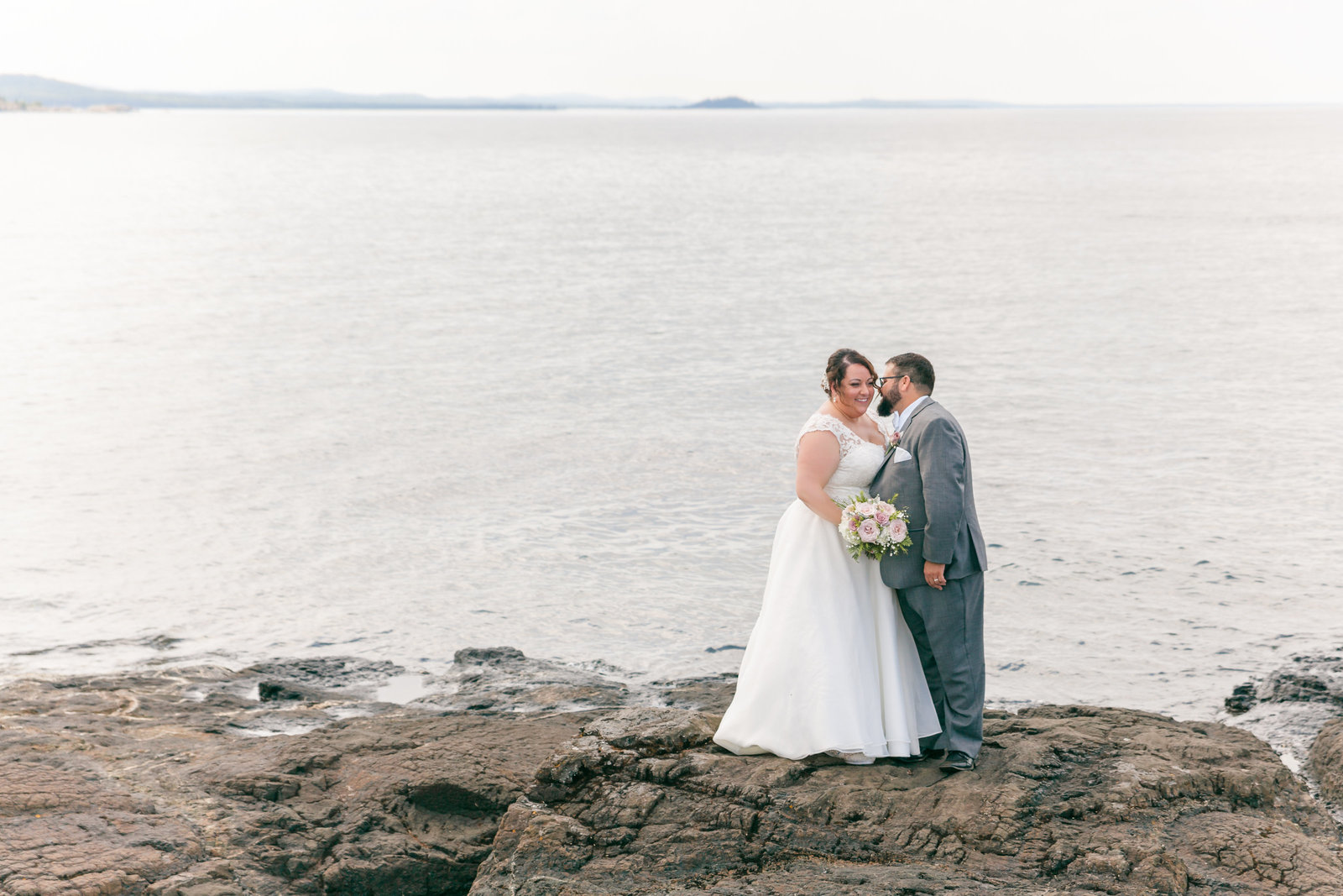 Bride and groom at Black Rocks on Marquette's Presque Isle Park