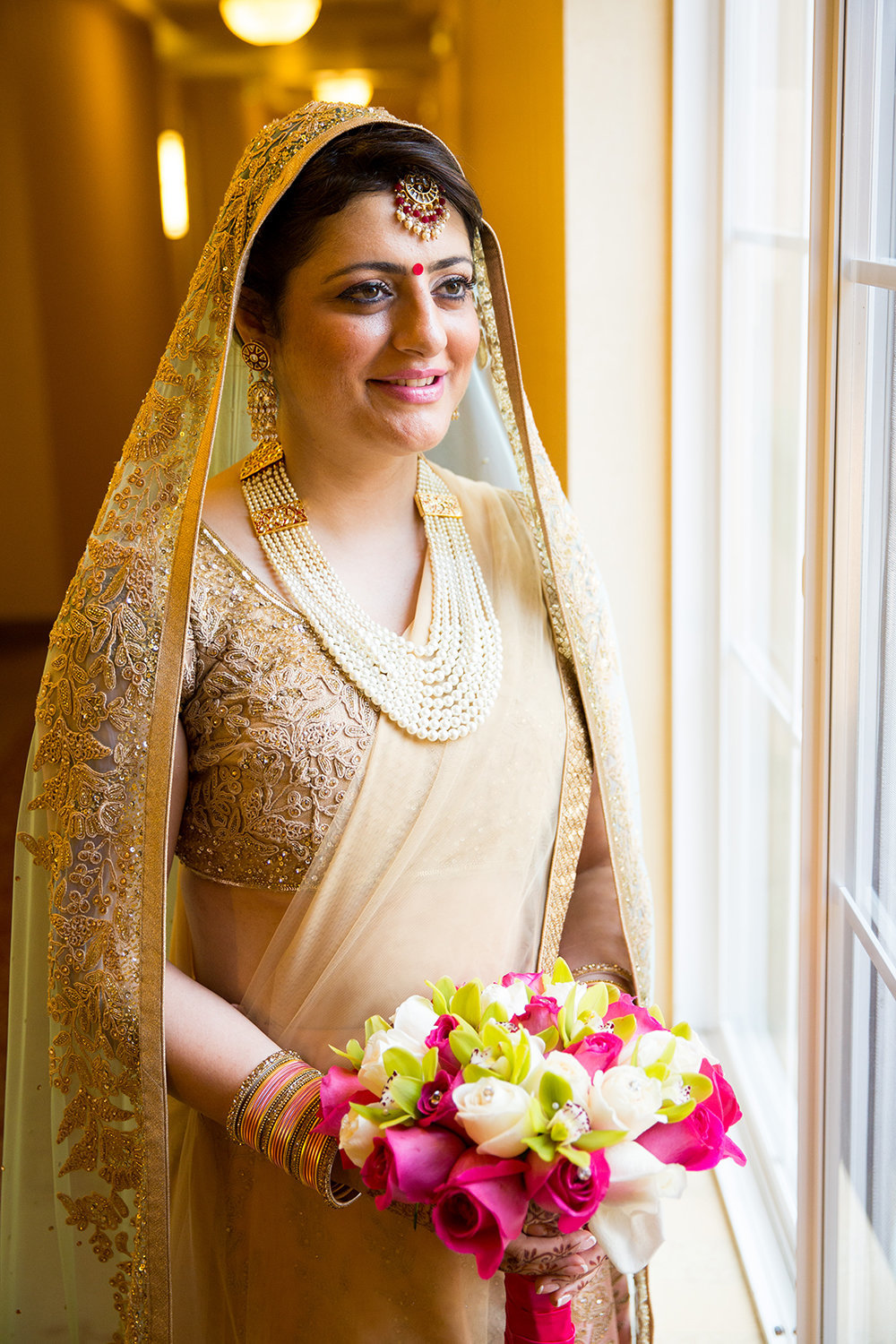 Bridal Portrait of Hindu Bride in Gold Sari