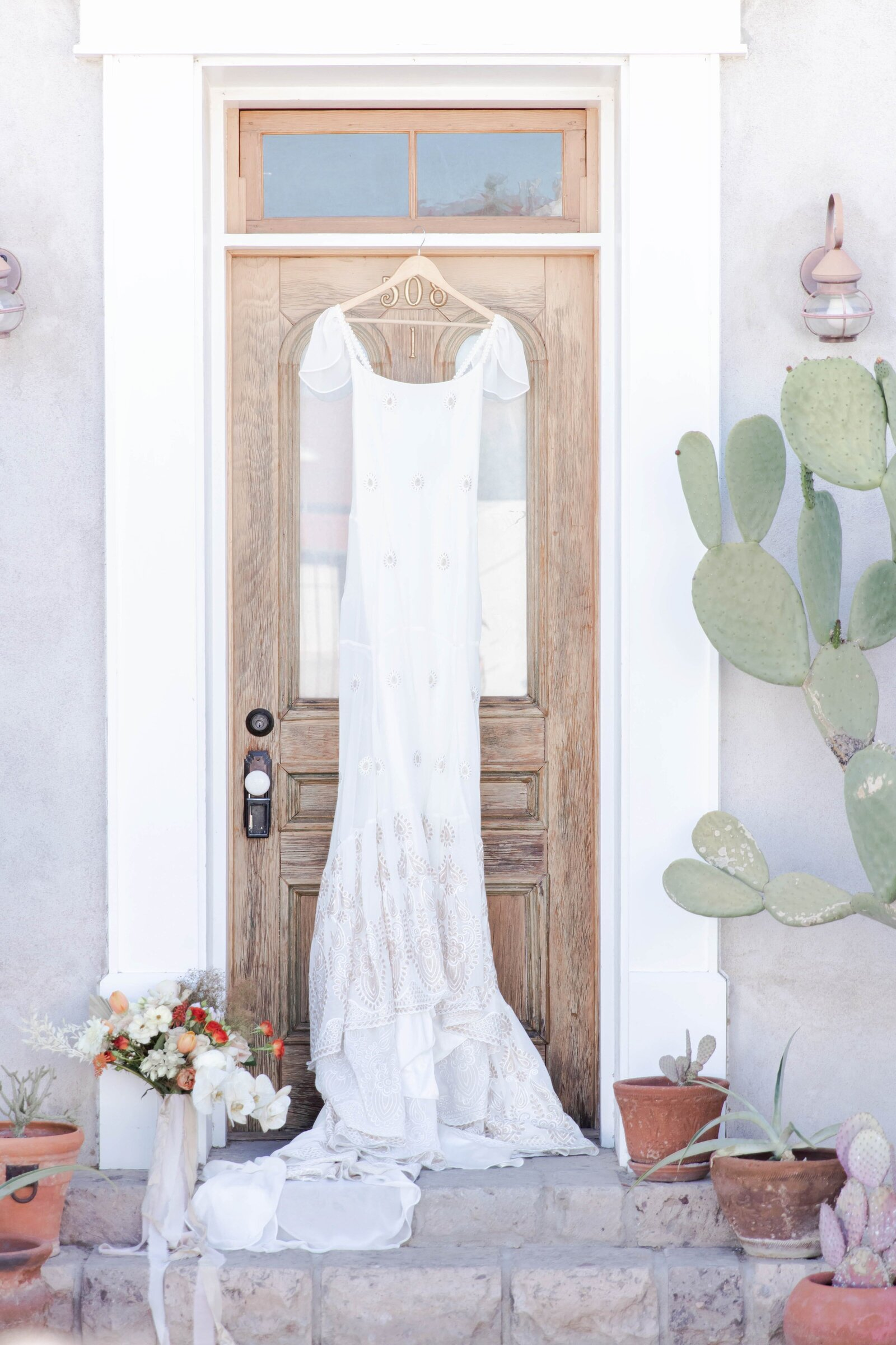 bridal-gown-hanging-on-door