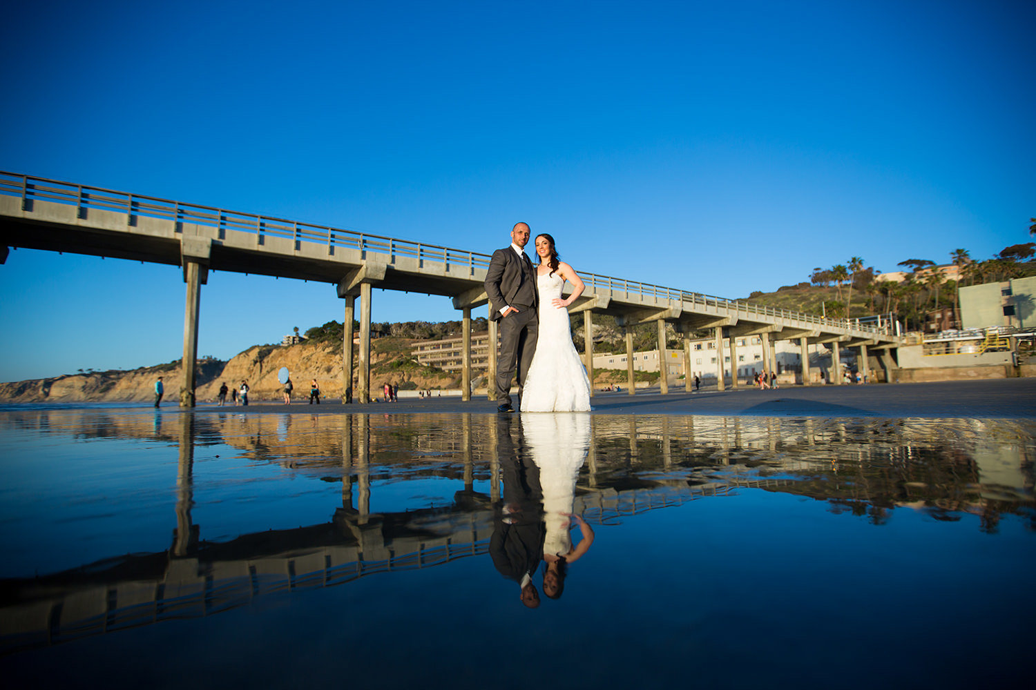 bride and groom with scripps pier