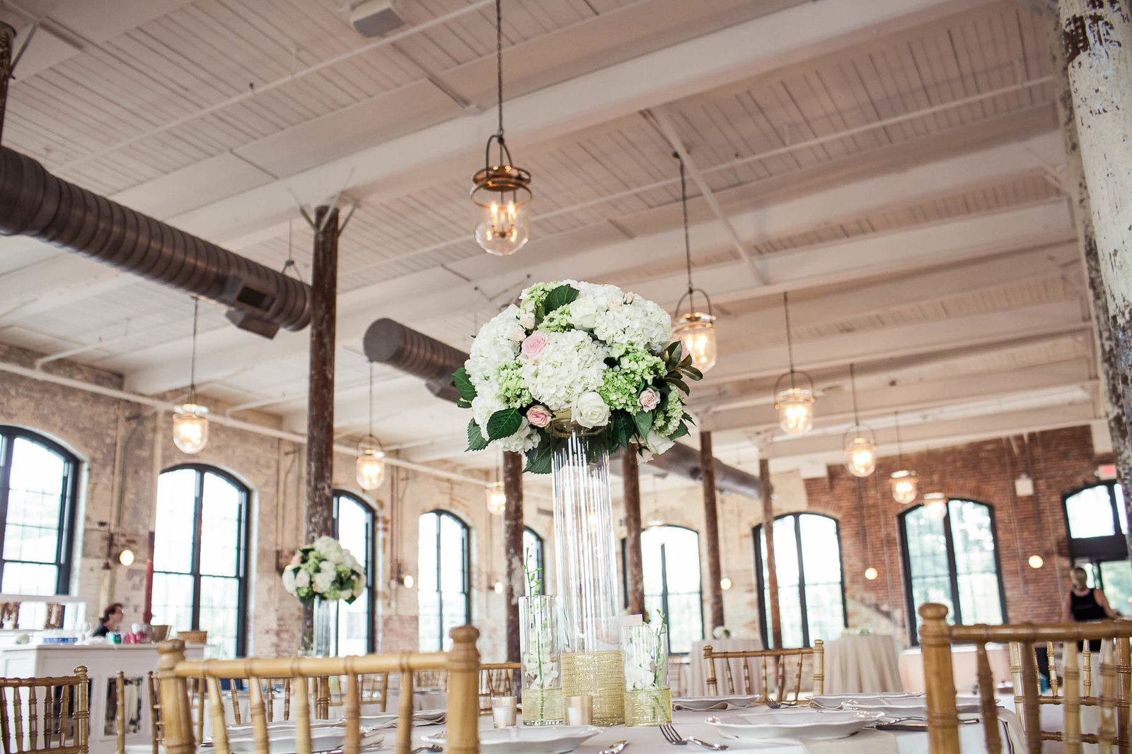 Tall flower centerpieces adorn The Cedar Room, Charleston, South Carolina