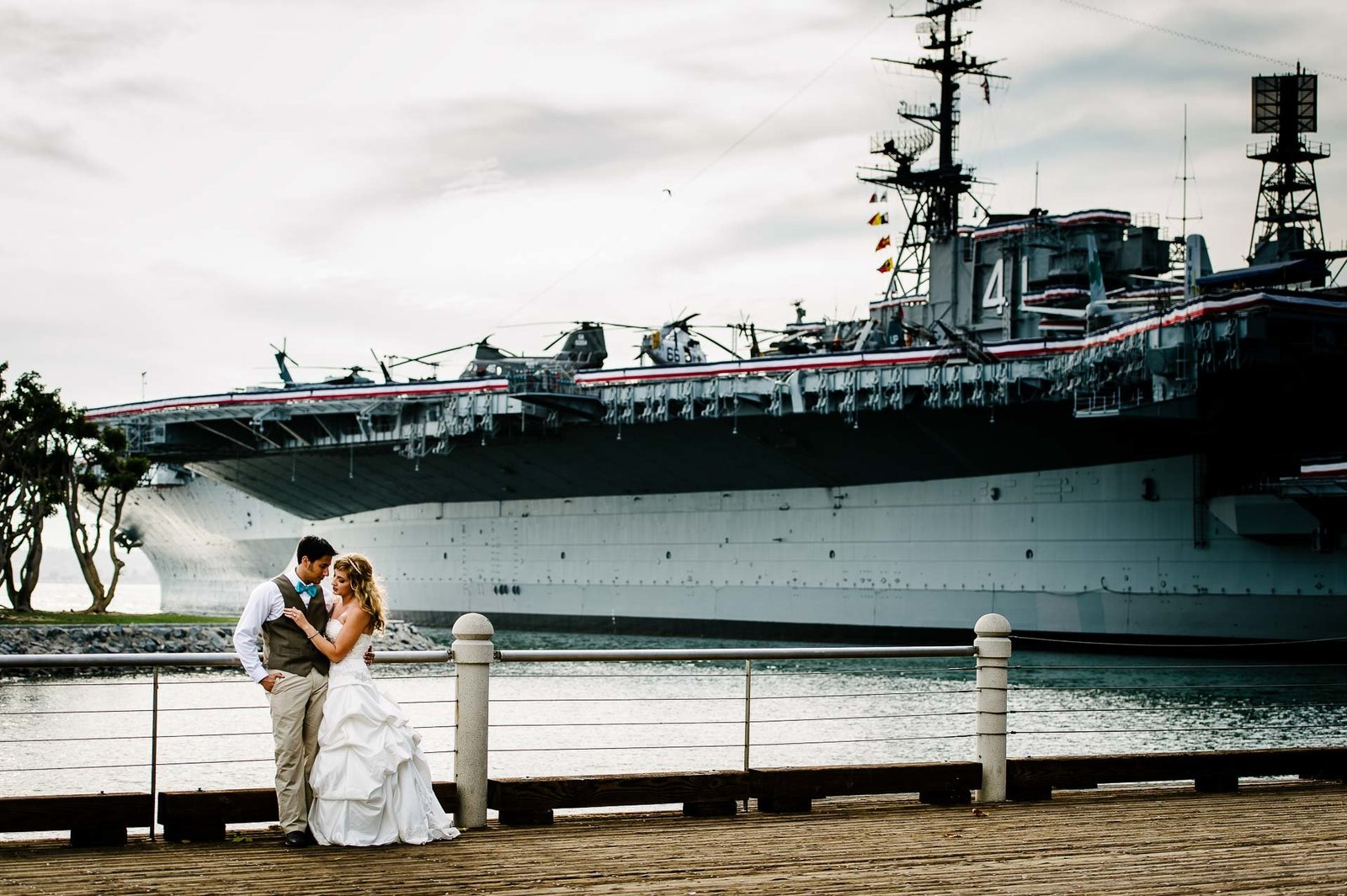 bride and groom in front of uss midway in san diego