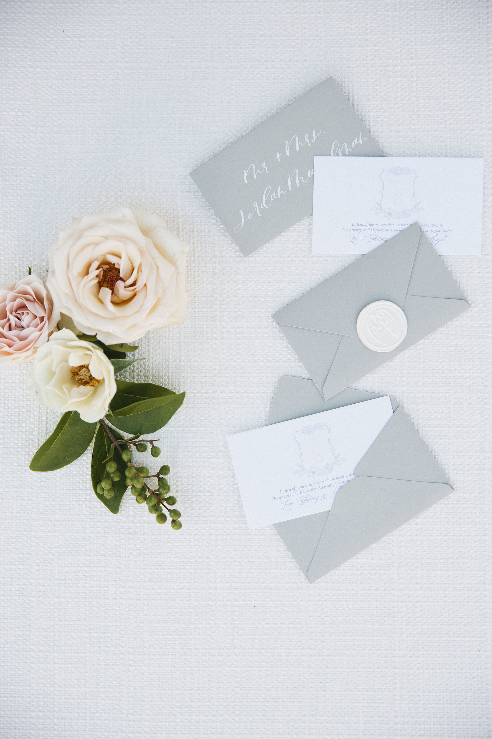 Escort cards with envelopes and wax seals for an escort card display