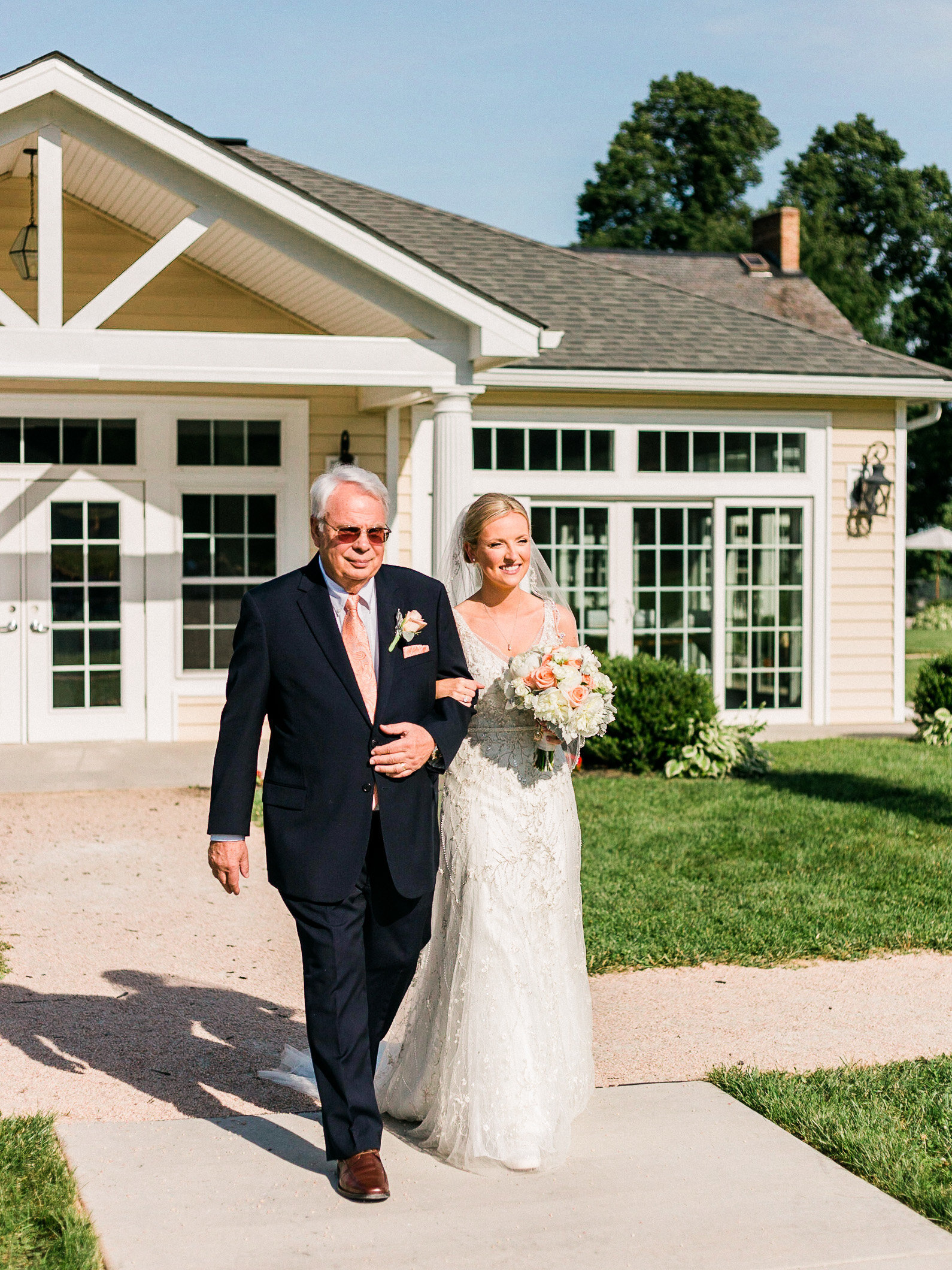 Father walks down the aisle with his  his daughter on her wedding at Springfield Manor Maryland
