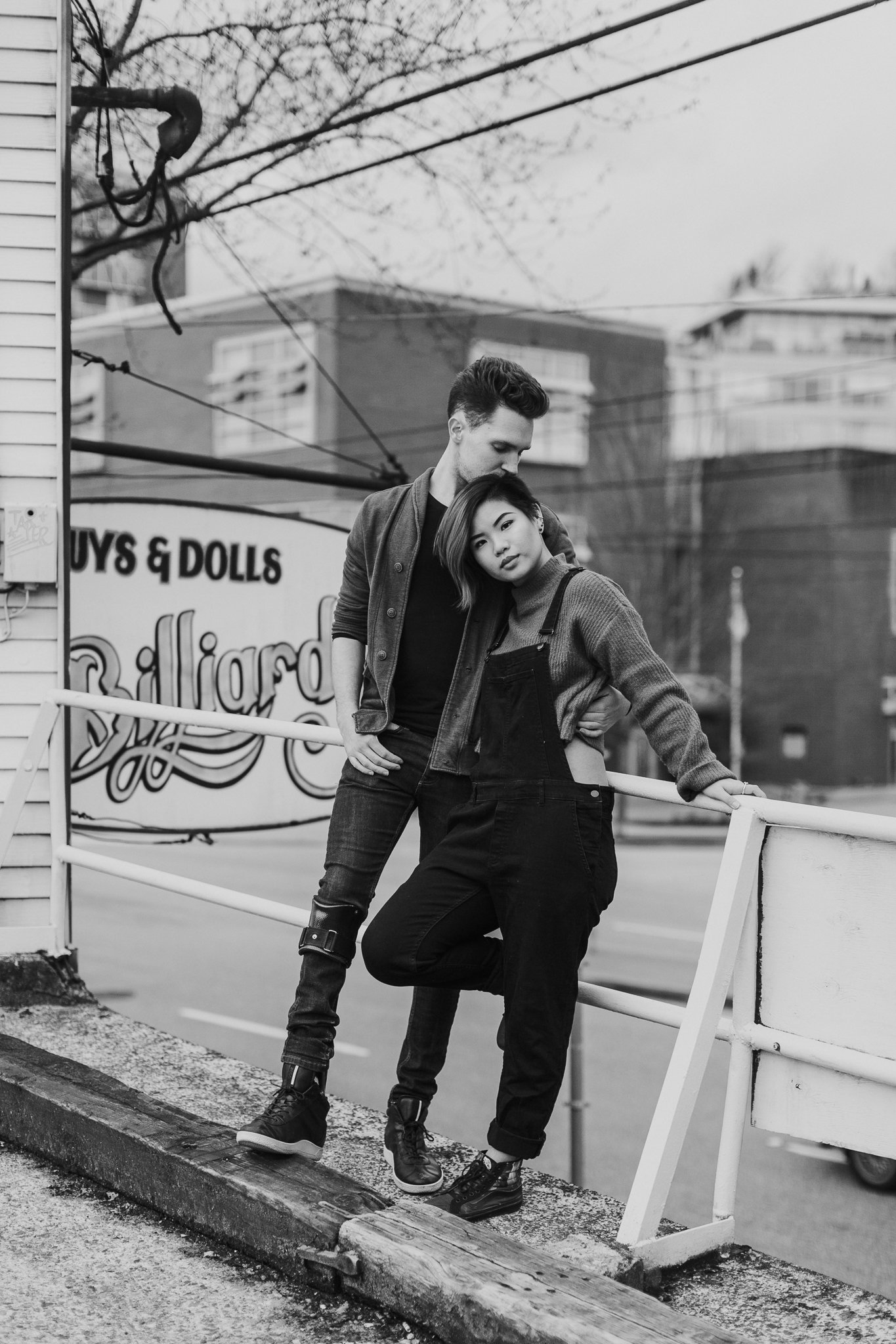 Cool stylish couple posing on Main street in Vancouver BC