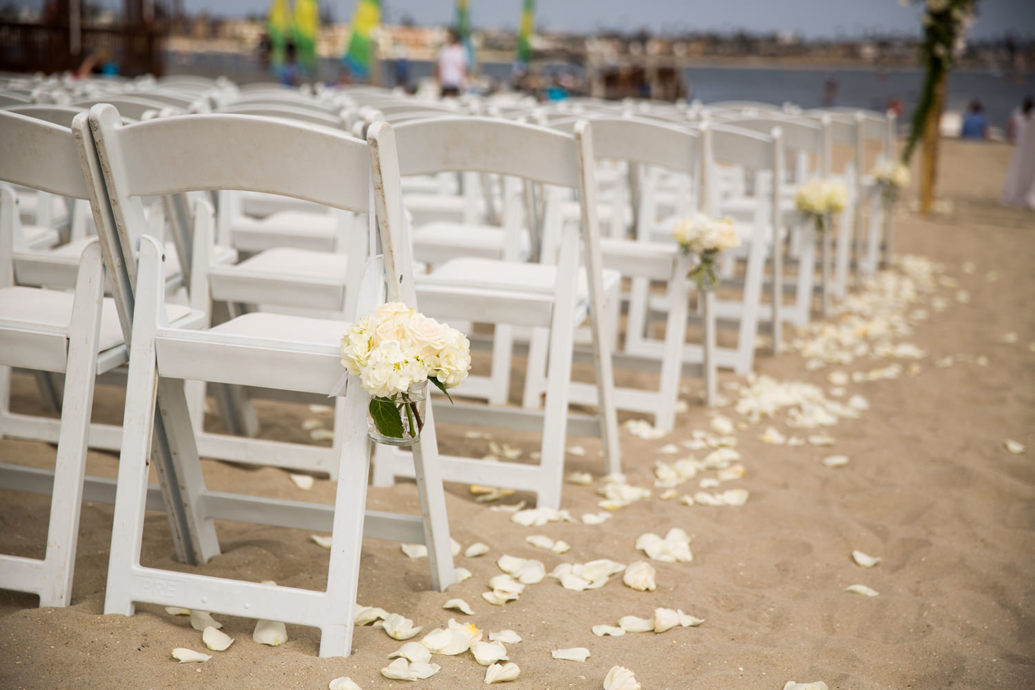 ceremony with roses petals in the sand
