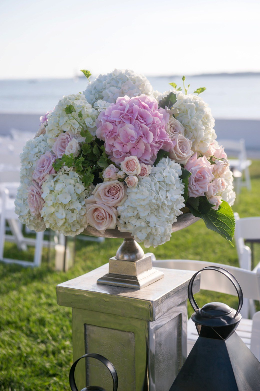 Classic ceremony flowers in purple, peach, blush pink and ivory