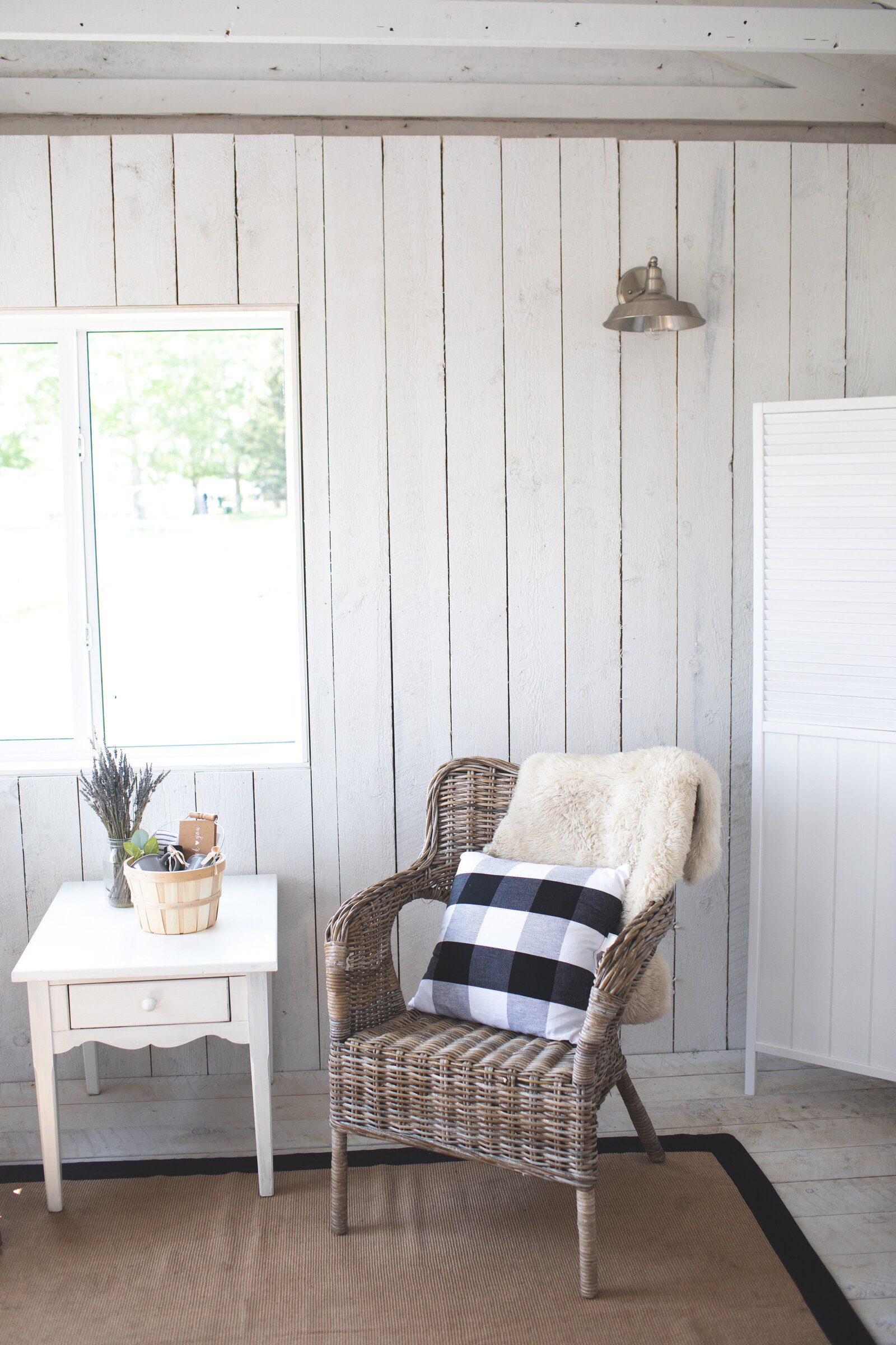 wicker chair with plaid pillow