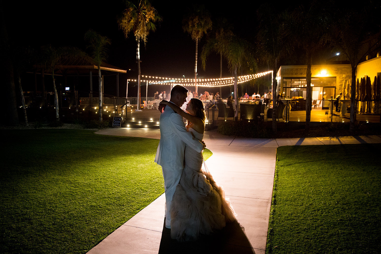 night image of bride and groom at ocean view room