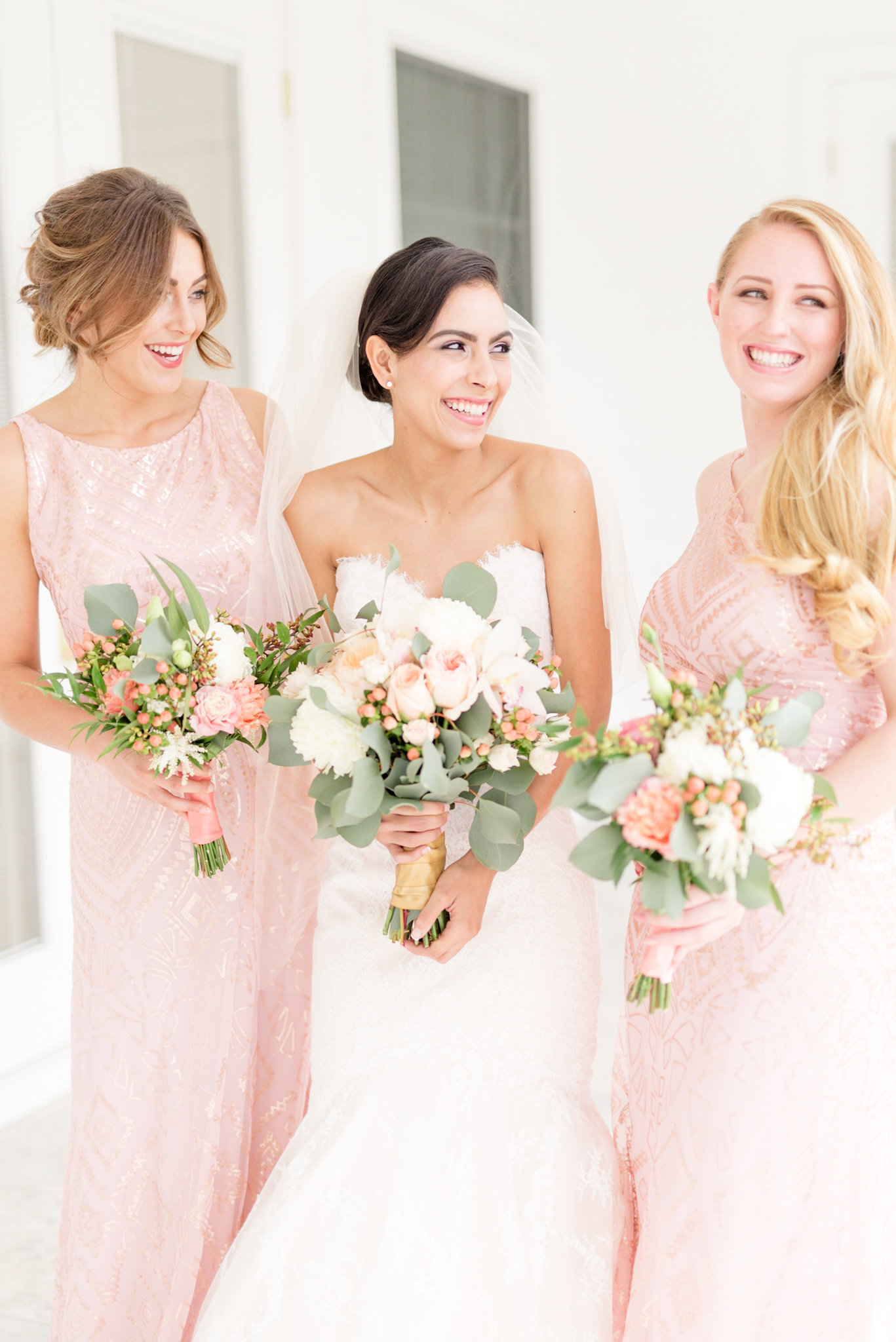 Bride and Bridesmaids laugh during portraits.