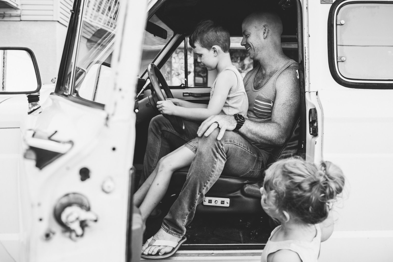Dad and young son in old jeep for family photos