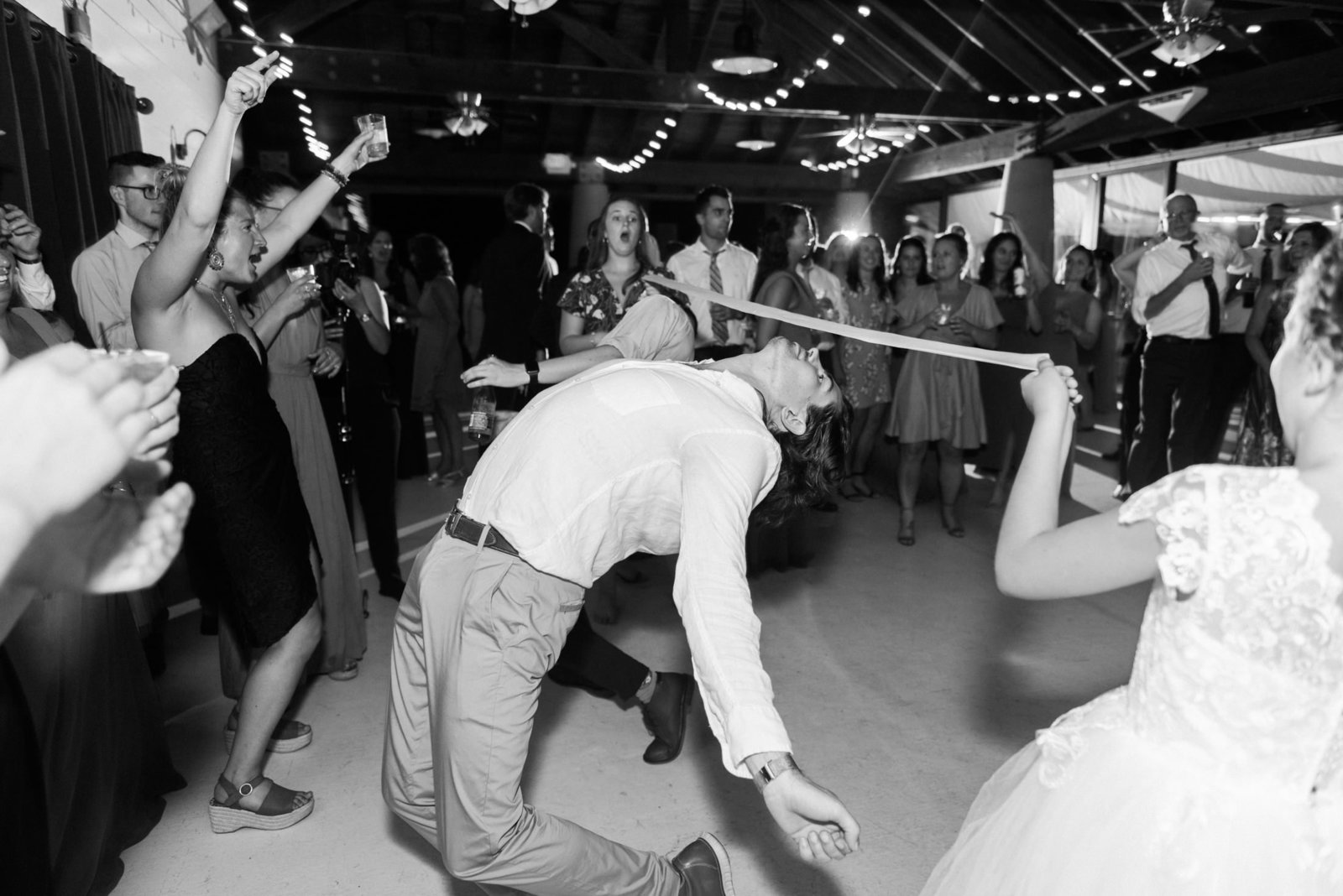 Dancing and playing limbo at a Plimoth Plantation wedding in Plymouth MA