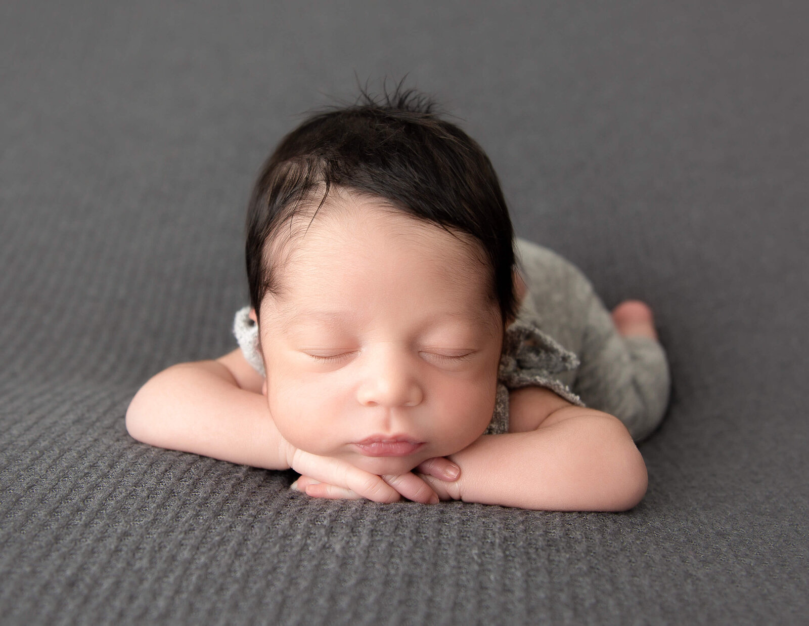 Precious newborn posed in our Rochester, Ny studio.