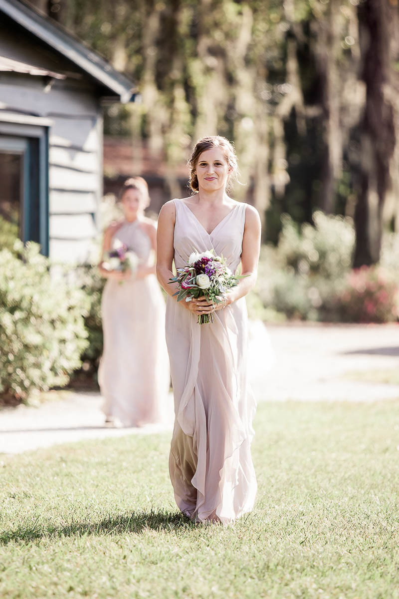 Bridesmaids walk up the aisle, Magnolia Plantation, Charleston, South Carolina