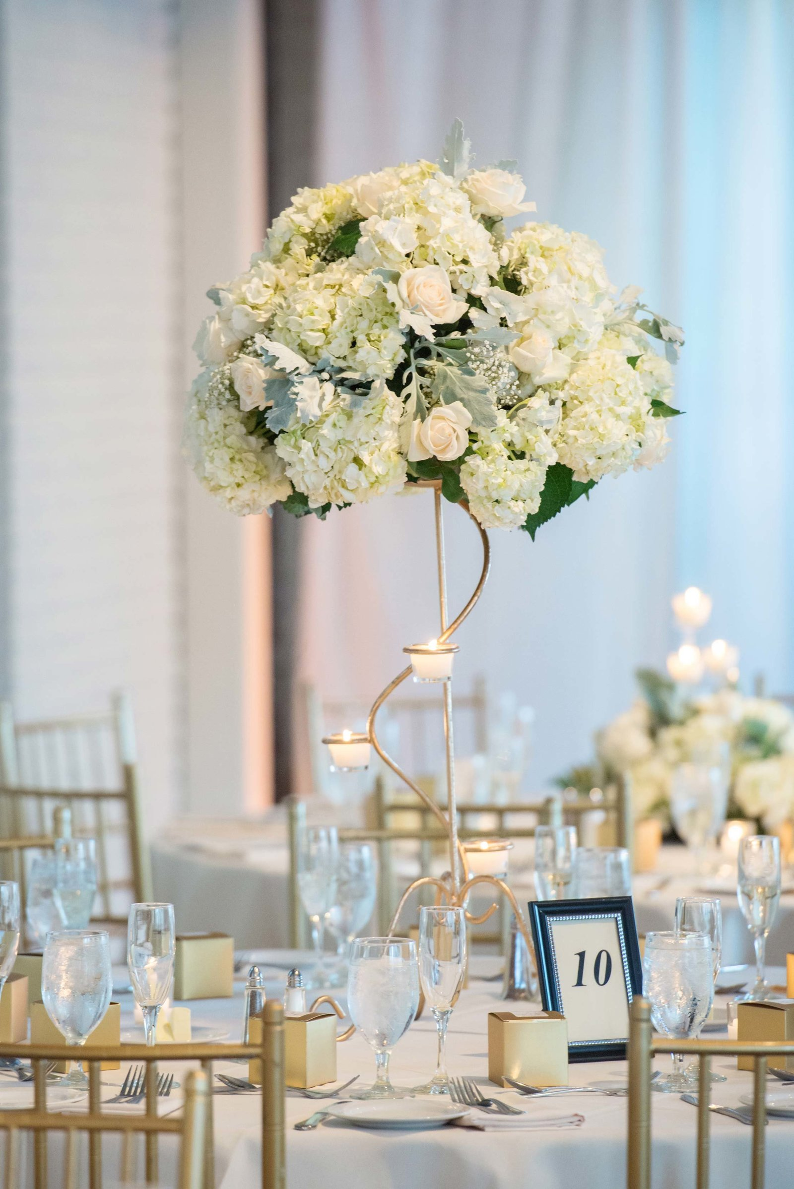 White wedding centerpiece at Coindre Hall