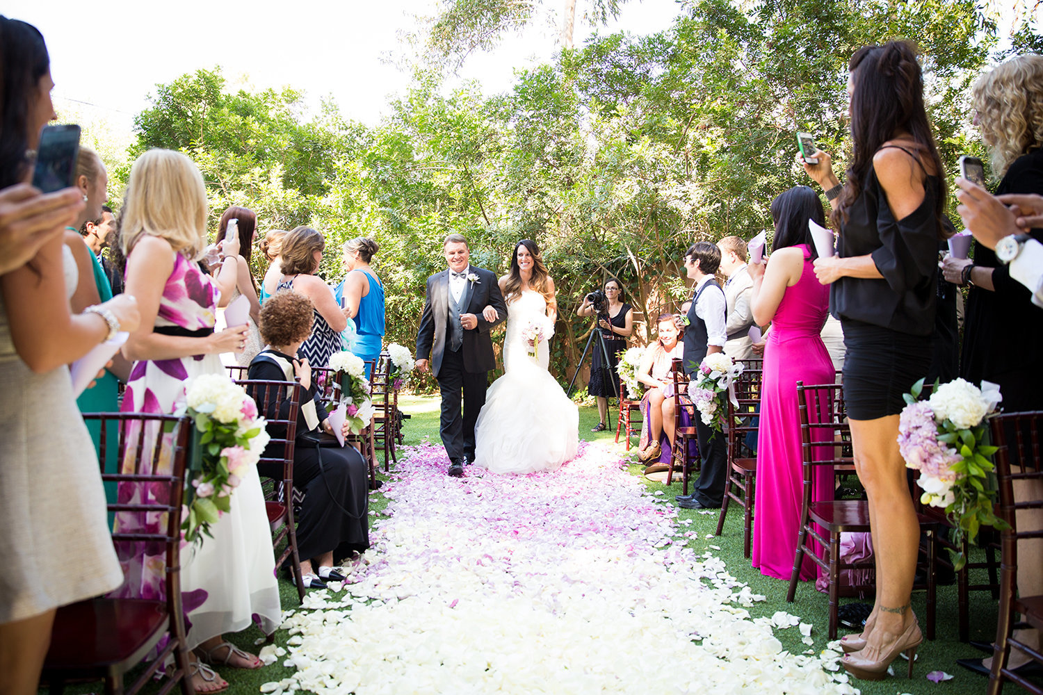 Here comes the bride | Colorful flower petal aisle wedding decorations